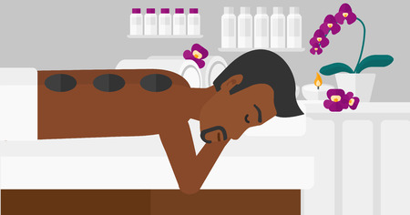 An african-american man relaxing while getting stone therapy massage on the background of spa center vector flat design illustration. Horizontal layout.