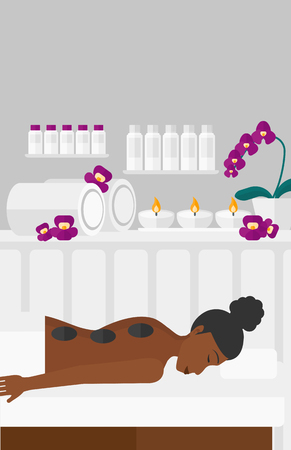 An african-american woman relaxing while getting stone therapy massage on the background of spa center vector flat design illustration. Vertical layout. Vettoriali