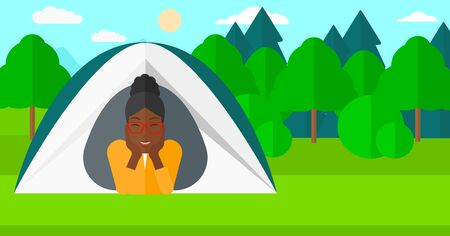 crawling: An african-american woman crawling out from a tent on the background of forest