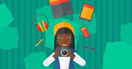 smart phone woman: An african-american woman holding a camera on a green background with gadgets vector flat design illustration. Horizontal layout. Illustration