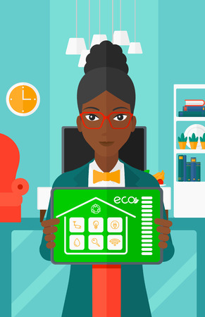 An african-american woman holding a tablet computer with smart home application on a screen on the background of modern  living room vector flat design illustration. Vertical layout. Illusztráció
