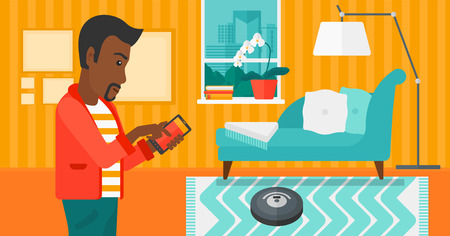 living room design: An african-american man controlling robot vacuum cleaner with his smartphone on the background of living room vector flat design illustration. Horizontal layout.