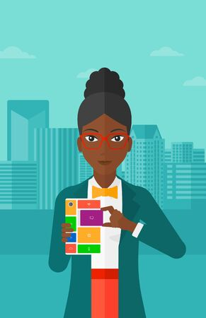 An african-american woman holding modular phone on a city background vector flat design illustration. Vertical layout.