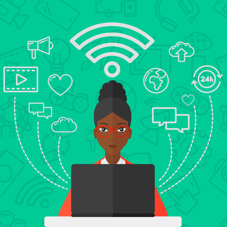 african business: An african-american woman working on a laptop and social computer network icons above her on a green background with technology icons vector flat design illustration. Square layout.