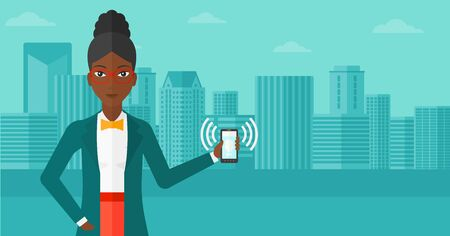 An african-american woman holding vibrating smartphone on a city background vector flat design illustration. Horizontal layout.