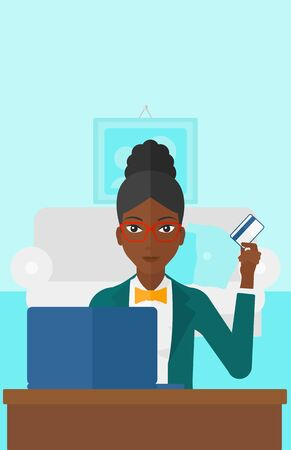 woman credit card: An african-american woman sitting in front of laptop with credit card in hand and making purchases online on the background of living room vector flat design illustration. Vertical layout.