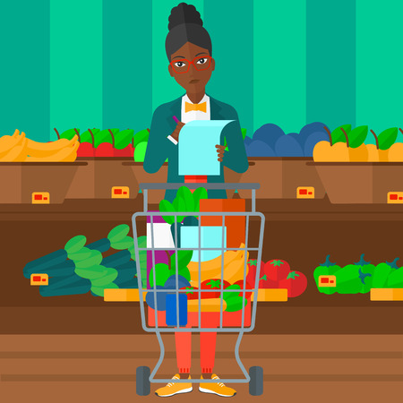 A thoughtful african-american woman standing with full supermarket trolley and holding a shopping list in hands on the background of shelves with vegetables and fruits in supermarket vector flat design illustration. Square layout. Illustration