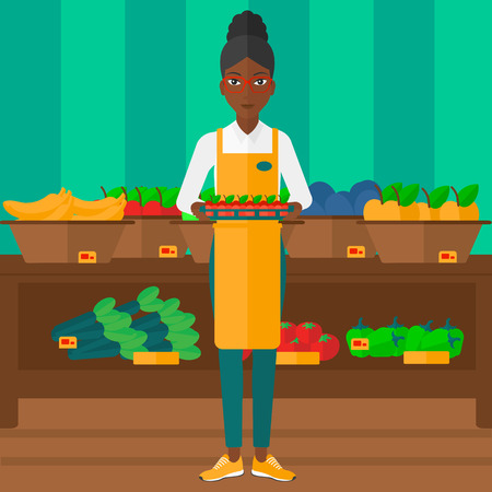 An african-american woman holding a box with apples on the background of shelves with vegetables and fruits in supermarket vector flat design illustration. Square layout. Vettoriali