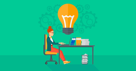 A business woman working on a laptop and a big light bulb above the table on the background of office vector flat design illustration. Horizontal layout. Illusztráció