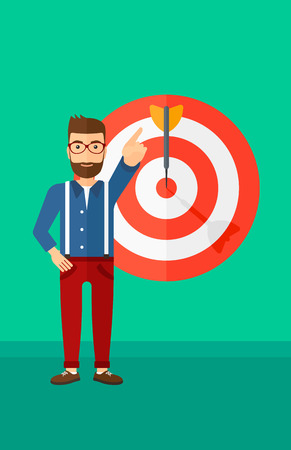 A hipster man with the beard pointing at arrow in a target board on a green background vector flat design illustration. Vertical layout.