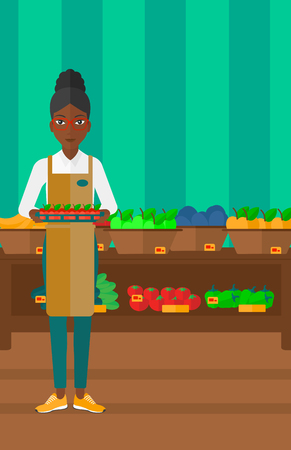 An african-american woman holding a box with apples on the background of shelves with vegetables and fruits in supermarket vector flat design illustration. Vertical layout.
