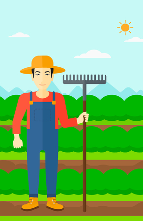 agrarian: An asian man standing with a rake on the background of field rows with green bushes vector flat design illustration. Vertical layout. Illustration