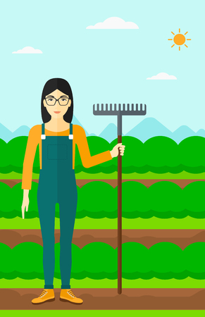 plant stand: An asian woman standing with a rake on the background of field rows with green bushes vector flat design illustration. Vertical layout. Illustration