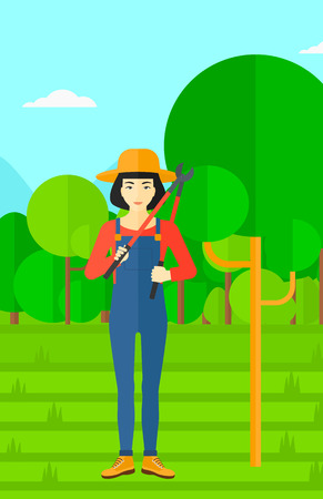 vertical garden: An asian woman holding a pruner on a background of garden with trees vector flat design illustration. Vertical layout. Illustration