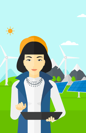 e reader: An asian woman holding a tablet computer in hands on a background with solar pannels and wind turbins vector flat design illustration. Vertical layout.