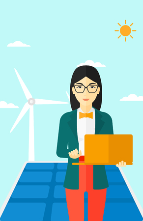 An asian woman holding a laptop in hands on a background with solar pannels and wind turbins vector flat design illustration. Vertical layout. Stock fotó - 54047699