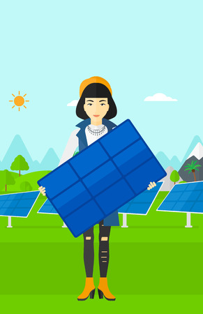asian cartoon: An asian woman holding a solar panel in hands on a background with solar panels vector flat design illustration. Vertical layout. Illustration