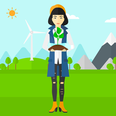 small plant: An asian woman standing on a background with wind turbins and holding in hands a plastic bottle with a small plant growing inside vector flat design illustration. Square layout.