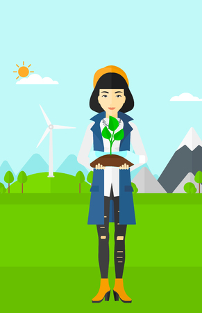 An asian woman standing on a background with wind turbins and holding in hands a plastic bottle with a small plant growing inside vector flat design illustration. Vertical layout.