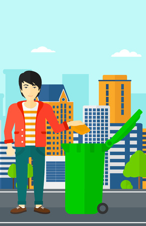 An asian man throwing a trash into a green bin on a city background vector flat design illustration. Vertical layout. Illustration