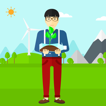 small plant: An asian man standing on a background with wind turbins and holding in hands a plastic bottle with a small plant growing inside vector flat design illustration. Square layout. Illustration