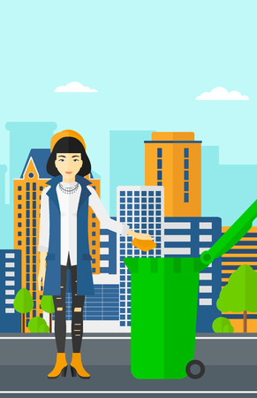 woman throwing: An asian woman throwing a trash into a green bin on a city background vector flat design illustration. Vertical layout.