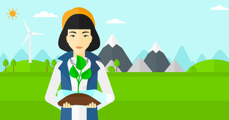 small plant: An asian woman standing on a background with wind turbins and holding in hands a plastic bottle with a small plant growing inside vector flat design illustration. Horizontal layout. Illustration