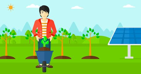 planted: An asian man standing with a plant and soil in a wheelbarrow on a background with newly planted trees and solar panels vector flat design illustration. Horizontal layout.