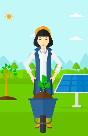 Eine asiatische Frau mit einer Pflanze und Boden auf einem Hintergrund mit neu gepflanzten Bäumen und Sonnenkollektoren Vektor flache Design-Abbildung in einer Schubkarre stehen. Vertikal-Layout.