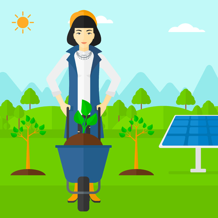 planted: An asian woman standing with a plant and soil in a wheelbarrow on a background with newly planted trees and solar panels vector flat design illustration. Square layout.