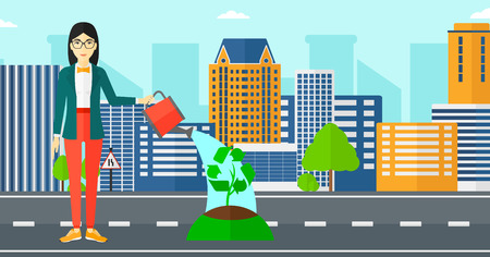 An asian woman watering a tree with a recycle sign instead of crown on a city backround vector flat design illustration. Horizontal layout.