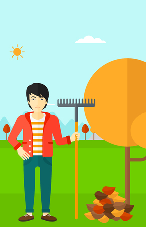 fall trees: An asian man with rake standing near tree and heap of autumn leaves vector flat design illustration. Vertical layout.