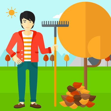 asian gardening: An asian man with rake standing near tree and heap of autumn leaves vector flat design illustration. Square layout.