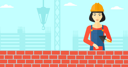 brick and mortar: An asian female bricklayer with a spatula and a brick in hands on a background of construction site vector flat design illustration. Horizontal layout.