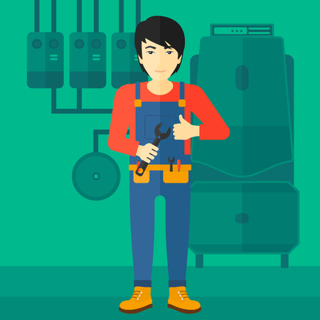 boiler: An asian man with a spanner in hand showing thumb up sign on a background of domestic household boiler room with heating system and pipes vector flat design illustration. Square layout.