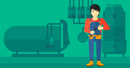 An asian man with a spanner in hand showing thumb up sign on a background of domestic household boiler room with heating system and pipes vector flat design illustration. Horizontal layout.