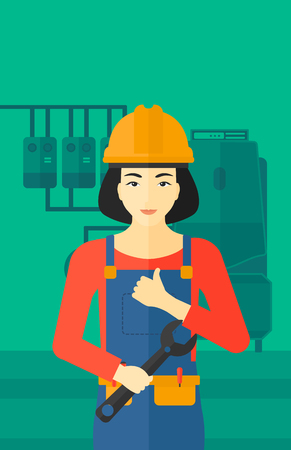 An asian female repairer engineer with a spanner in hand showing thumb up sign on a background of domestic household boiler room with heating system and pipes vector flat design illustration. Vertical layout.