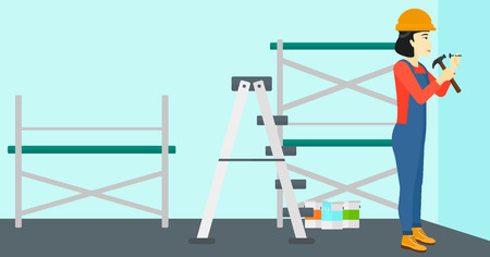 An asian woman hitting a nail in the wall with a hummer on a background of room with paint cans and ladder vector flat design illustration. Horizontal layout.