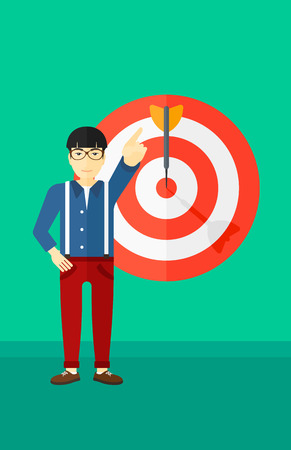 An asian man pointing at arrow in a target board on a green background vector flat design illustration. Vertical layout.
