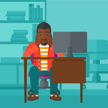An african-american man sitting at the table in front of computer monitor and clutching his head on the background of business office vector flat design illustration. Square layout.