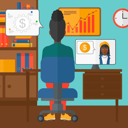 An african-american woman sitting in the office and talking with other woman using video chat vector flat design illustration. Square layout. Ilustrace