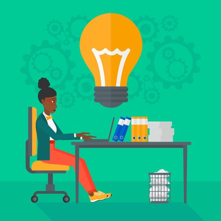 An african-american business woman working on a laptop and a big light bulb above the table on the background of office vector flat design illustration. Square layout. Illusztráció