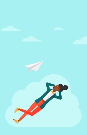 flying paper: An african-american woman lying on a cloud and looking at flying paper plane on the background of blue sky vector flat design illustration. Vertical layout. Illustration
