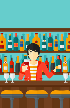 bar counter: An asian bartender standing at the bar counter and holding a bottle and a glass in hands vector flat design illustration. Vertical layout.