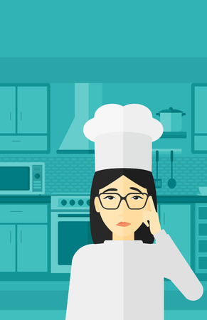 An asian cheerful chief-cooker in uniform standing in the kitchen and pointing forefinger up vector flat design illustration. Vertical layout. 向量圖像