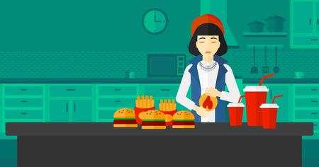 fire in the belly: An asian woman standing in the kitchen in front of table full of junk food and suffering from heartburn vector flat design illustration. Horizontal layout.