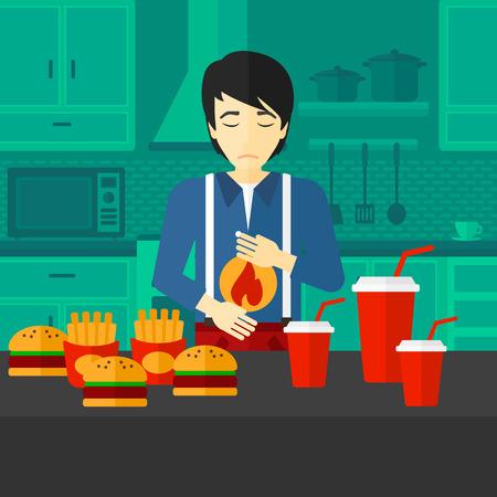 Een Aziatische man die in de keuken voor de tafel vol met junk food en die lijden aan maagzuur vector platte ontwerp illustratie. Vierkante lay-out.
