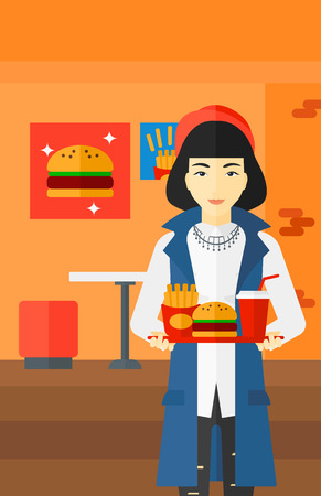 An asian woman holding a tray full of junk food on a cafe background vector flat design illustration. Vertical layout.