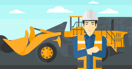 An asian miner standing in front of a big mining equipment on the background of coal mine vector flat design illustration. Horizontal layout. Ilustração