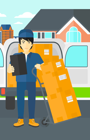 An asian delivery man standing near cart with boxes and holding a file in a hand on the background of delivery truck and a house vector flat design illustration. Vertical layout.